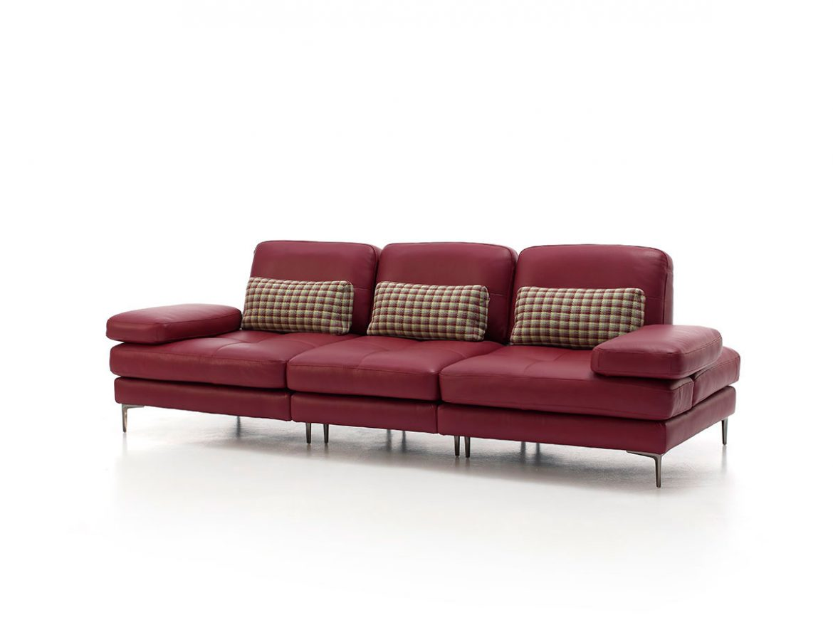 Same model, 3/4 light front view. Modular sofa placed in white cyclorama.