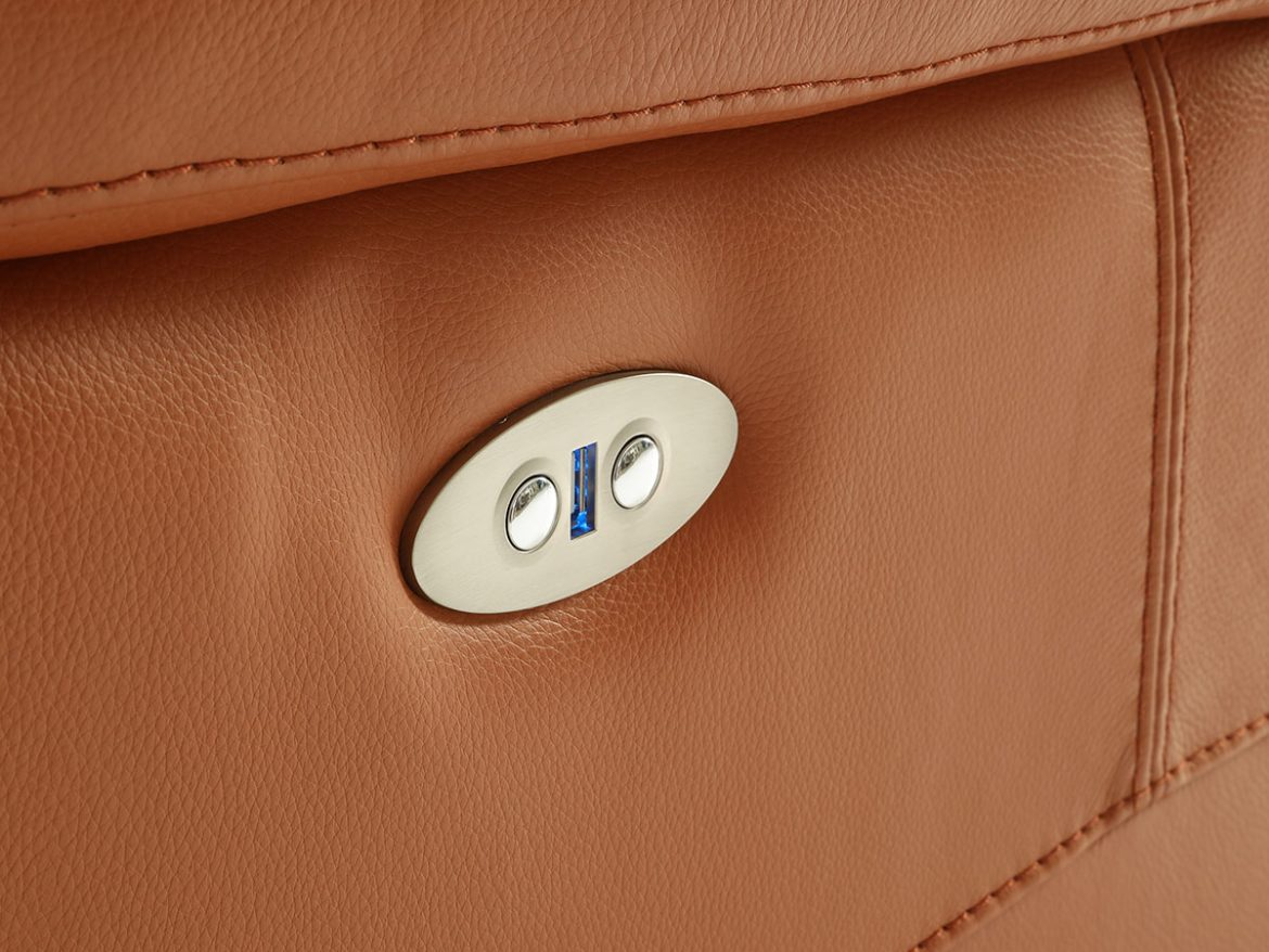 Detail of the arm and side of the Lea model sofa. It has two buttons incorporated to activate the relax.