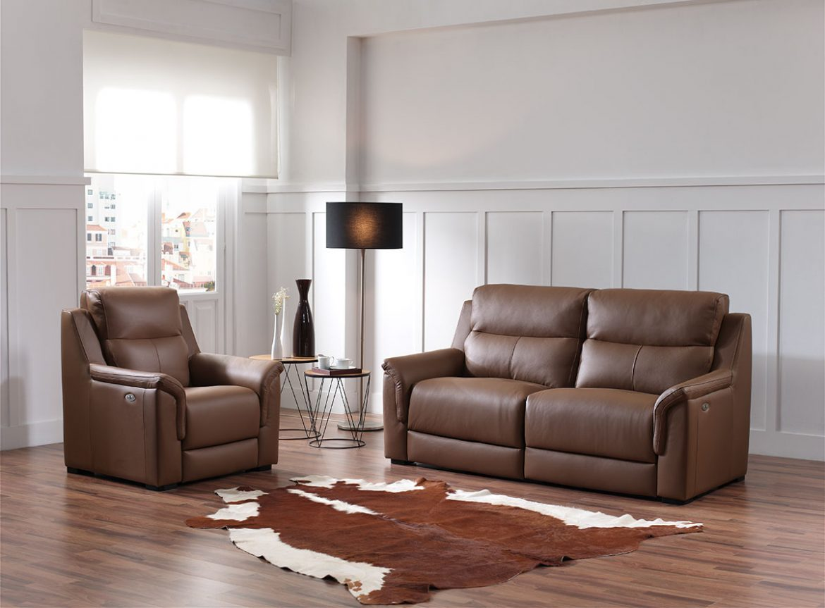 Mini models in brown leather. The rest products are presented in a sober decorated white walls and parquet floor. Natural light passes through a window where buildings are seen
