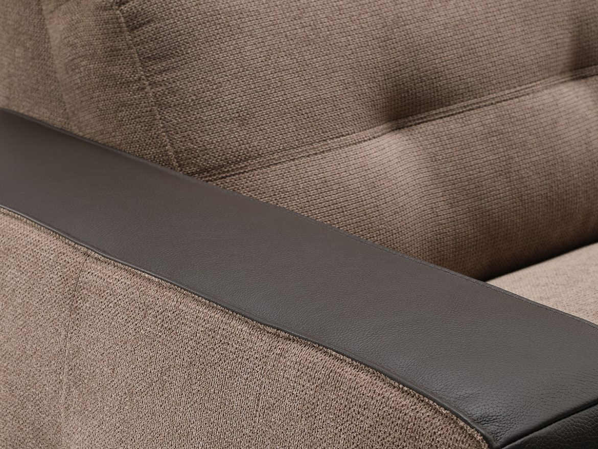 Detail of the chaise longue Code arm upholstered in dark brown leather.
