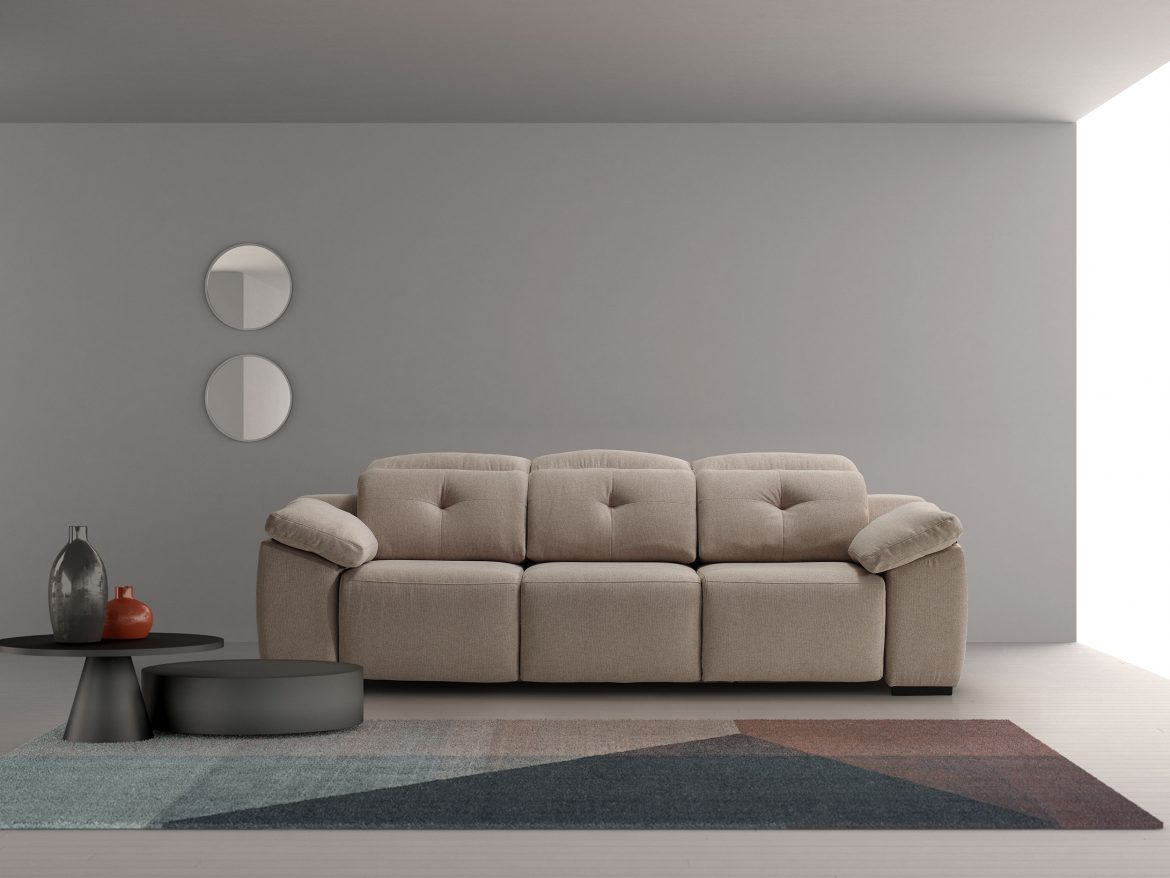 Sea model in earth color with decorated gray wall and table and loft in black with two circular mirrors and carpet in desaturated colors and finally clay vases