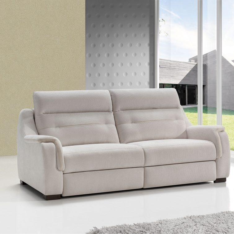 Sofa located in an empty room with a window on the right where you can see a lawn and a minimalist construction of gray blocks and geometric shapes